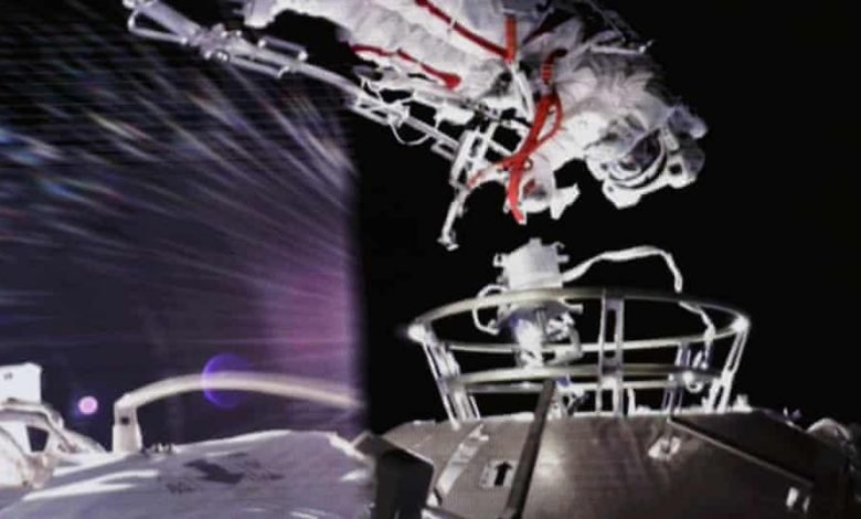 Two astronauts at China's new space station make first spacewalk