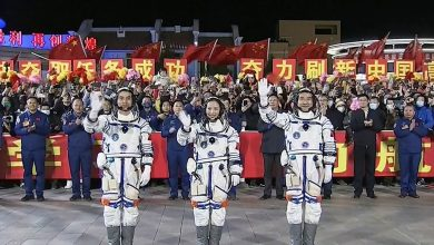 China begins its longest mission in space as three astronauts board under-construction space station